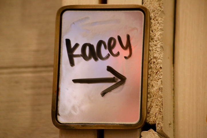 Handwritten customer name on a sign outside of dressing room